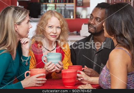 Mature Woman with Sympathetic Friends stock photo, Mature European woman with sympathetic friends in coffeehouse by Scott Griessel