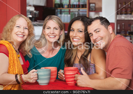 Happy Friends at Cafe Table stock photo, Four Hispanic and Caucasian friends at table in cafe by Scott Griessel
