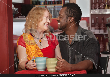 Smiling Mixed Couple in Cafe stock photo, Smiling mixed Black and white couple in cafe by Scott Griessel
