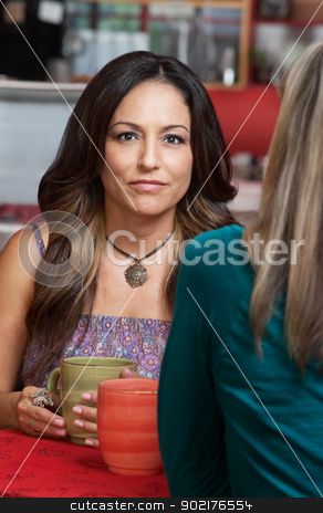 Hispanic Woman with Friend in Cafe stock photo, Beautiful Hispanic woman with friend in restaurant by Scott Griessel