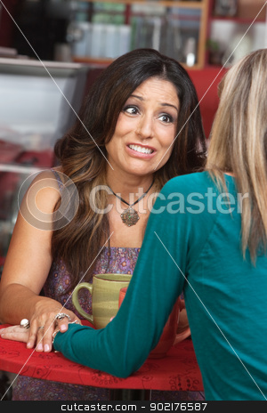 Woman Holding Friends Hand stock photo, Caring woman holding friends hand in restaurant by Scott Griessel