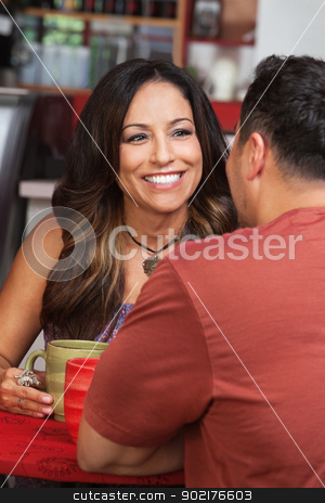 Lady with Male Friend in Cafe stock photo, Pretty Mexican woman with male friend in cafe by Scott Griessel