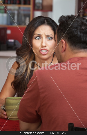 Furious Woman in Coffeehouse stock photo, Furious woman yelling at man in restaurant by Scott Griessel