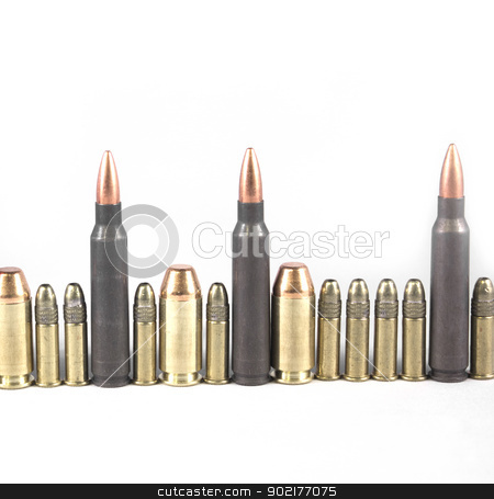 Bullets in a line isolated on white stock photo, High quality bullets on a white isolated background by Jeremy Baumann