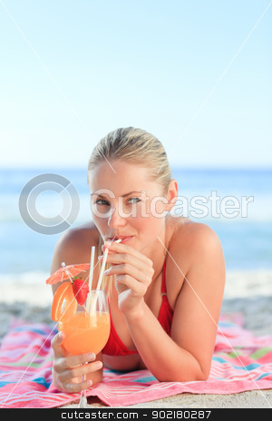 Cute woman drinking her cocktail stock photo, Cute woman drinking her cocktail by Wavebreak Media