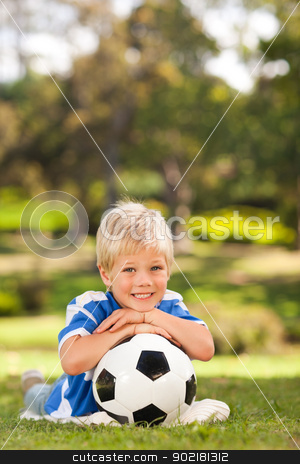 Boy with his ball in the park stock photo, Boy with his ball in the park by Wavebreak Media