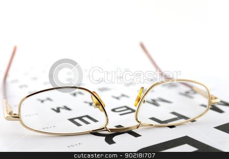 Eyeglasses on the ophthalmologic scale stock photo, Eyeglasses on the ophthalmologic scale. Shallow DOF. by Sergei Devyatkin