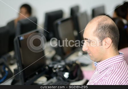 IT specialist stock photo, IT specialist working on a computer by ianmck
