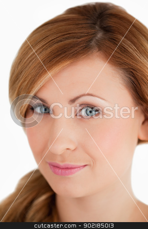 Young and attractive woman looking at the camera stock photo, Young and attractive woman looking at the camera on a white background by Wavebreak Media