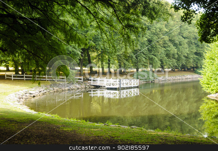 Quiet park and river stock photo, Green trees and grass in a very quiet park close to a river by Alessandro Rizzolli