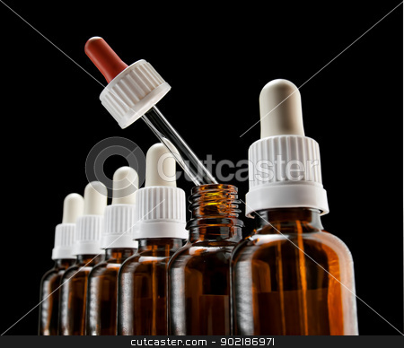 Different medication stock photo, Different color of one of droppers in a row can suggest an alternative choice in a medical therapy by Sinisa Botas