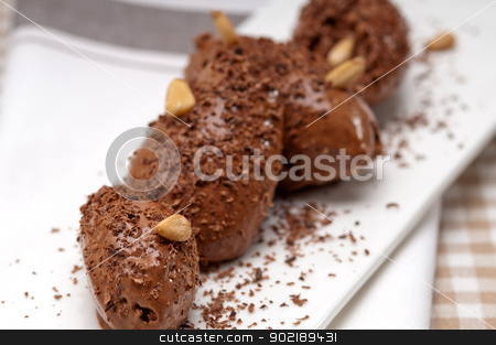 chocolate mousse quenelle dessert stock photo, fresh home made chocolate mousse quenelle dessert by Francesco Perre