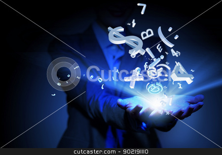 Business woman with financial symbols around stock photo, Businesswoman with financial symbols coming from her hand by Sergey Nivens