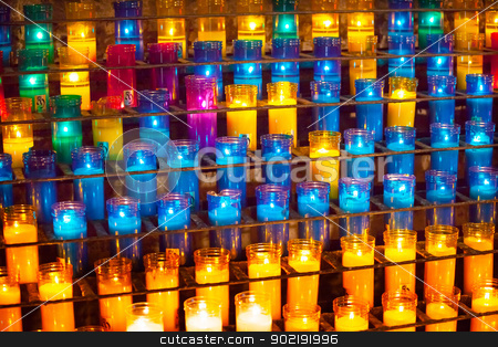 Prayer Candles Inside Basilica Monestir Monastery of Montserrat  stock photo, Prayer Candles Basilica Inside Monestir Monastery of Montserrat, Barcelona, Catalonia, Spain.  Founded in the 9th Century, destroyed in 1811 when French invaded Spain. Rebuilt in 1844 and now a Benedictine Monastery.  Placa de Santa Maria by William Perry