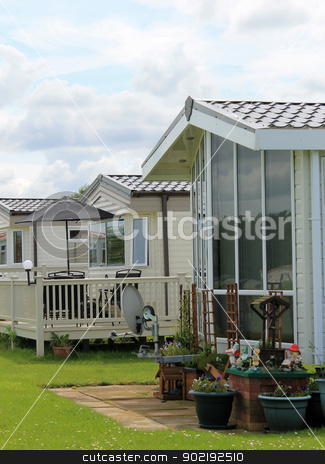 Mobile homes in trailer park stock photo, Exterior of mobile caravan homes in modern trailer park. by Martin Crowdy