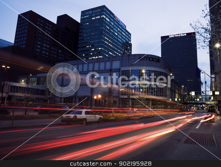 Morning traffic in Cincinnati stock photo, Cincinnati, Ohio, USA - Morning traffic in the center of Cincinnati. Seen with car lights before sunset with Macy's store and the city skyscrapers. by Henryk Sadura
