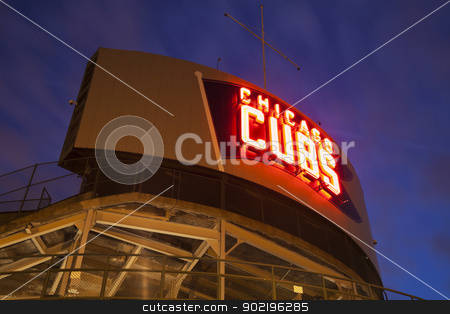 Wrigley Field stock photo, Chicago, Illinois, USA - March 31, 2012 Wrigley Field in Chicago, Illinois. Wrigley Field is a baseball stadium and home to Chicago Cubs. The stadium was opened in 1914 and can seat 42000 people. Seen during the sunset with the Chicago Cubs neon. by Henryk Sadura