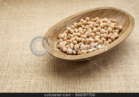 chickpea beans stock photo, chickpea (garbanzo) beans in a rustic wood bowl against burlap canvas by Marek Uliasz