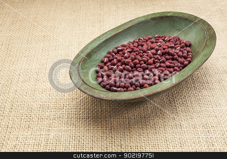 adzuki beans stock photo, Japanese adzuki (aduki, azuki) beans in a rustic wood bowl against burlap canvas by Marek Uliasz