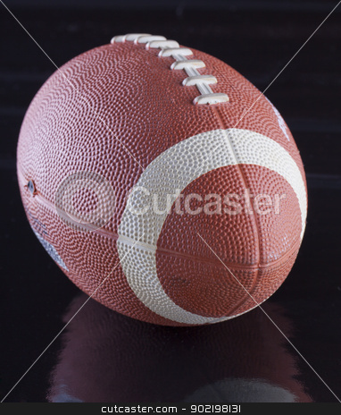 Football stock photo, View of a football over a black surface by Fabio Alcini