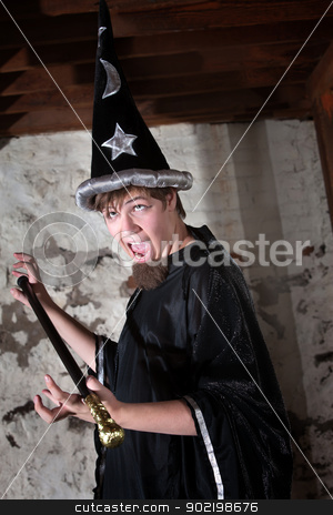 Wizard with Eyes Rolled Up stock photo, Funny young wizard holding a scepter with eyes rolled up by Scott Griessel