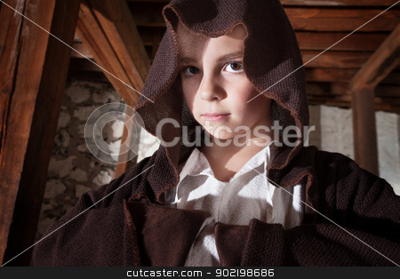 Magician with Folded Arms stock photo, Serious young magician with folded arms hidden in his cloak by Scott Griessel