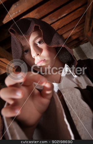 Young Magician with Hand Out stock photo, Young boy dressed as a science fiction character reaching out by Scott Griessel