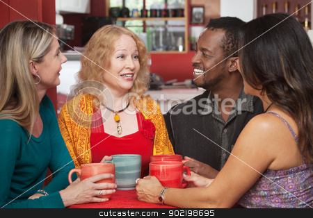 Joyful Group of Four in Cafe stock photo, Attractive group of adults sitting together in a restaurant by Scott Griessel