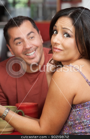 Embarrassed Woman and Flirting Man stock photo, Man flirting with attractive Mexican female in a cafe by Scott Griessel