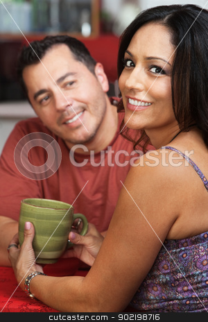 Attractive Mexican Couple stock photo, Attractive Mexican couple sitting together in a cafe by Scott Griessel
