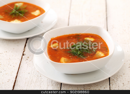 Image of bowls of hot red soup isolated stock photo, Image of two bowls of hot red soup isolated on white wooden table by yekostock