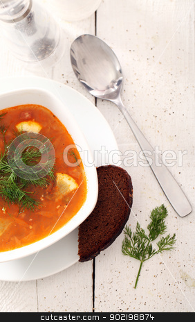 Image of bowl of hot red soup on wooden table stock photo, Image of bowl of hot red soup served with bead, pepper, salt and spoon on white wooden table by yekostock