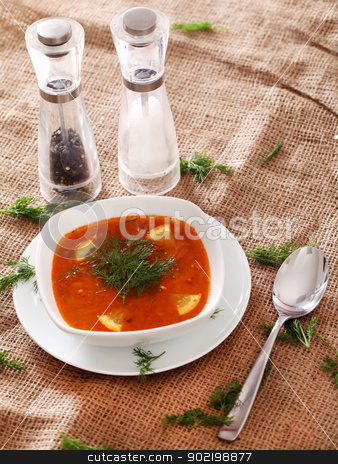Soup served with the salt, pepper and spoon stock photo, Image of bowl of hot red soup served with the salt, pepper and spoon on a beige tablecloth by yekostock