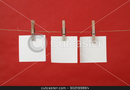 Memory note papers hanging on cord stock photo, memory note paper hanging on cord on red background by Artush