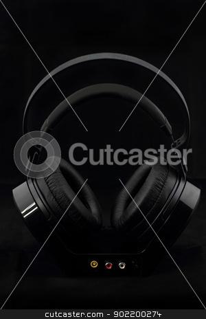 Headphones on black background stock photo, Black modern Headphones on a black background by Nneirda