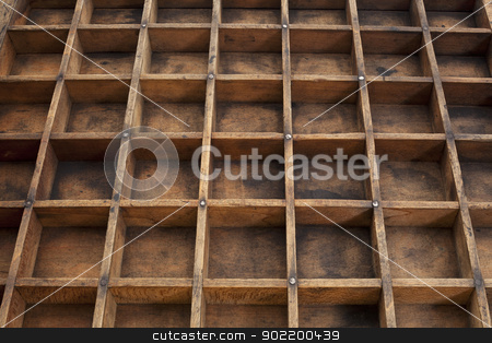 vintage typesetter drawer stock photo, detail of vintage grunge wood typesetter drawer with dividers by Marek Uliasz