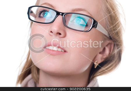 Close-up portrait of a girl with glasses facing upward stock photo, Close-up portrait of a girl with glasses facing upward. by Vadim