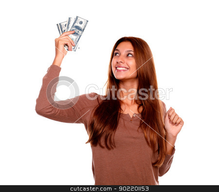 Smiling young woman holding up cash money stock photo, Portrait of a smiling and happy young woman holding up cash money with long brown hair on white background by pablocalvog