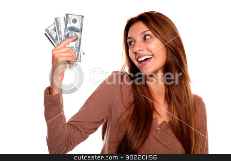 Smiling young female holding up cash money stock photo, Portrait of a smiling and happy young female holding up cash money with long brown hair on white background by pablocalvog