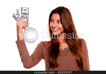 Young woman looking to right hand with cash money stock photo, Portrait of a young woman looking to right hand with cash money with long brow hair against white background by pablocalvog