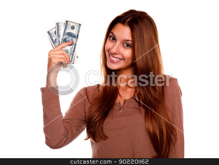 Charming and smiling young woman with cash money stock photo, Portrait of a charming and smiling young woman with cash money against white background by pablocalvog