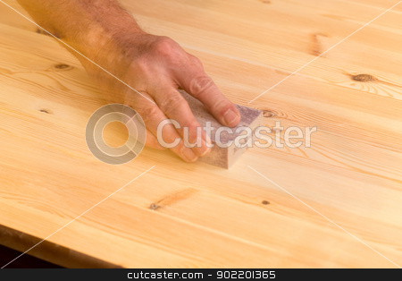 Mans hand on sanding block on pine wood stock photo, Man rubbing sanding block on pine floor or table with ghosting to suggest movement by Steven Heap