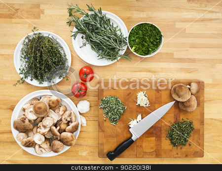 Vegetables And Chopping Board On Kitchen Counter stock photo, Various types of vegetables and chopping board with knife on kitchen counter by Corepics VOF