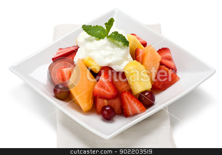Fruit Salad stock photo, A plate of fresh fruit salad with yogurt and garnished with mint on white background. by Glenn Price