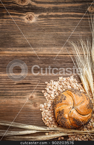 Bread roll and weath stock photo, Bread roll and weath on old wooden table by Grafvision