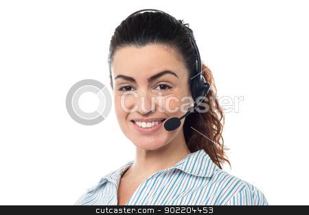 Closeup smiling portrait of a call centre executive stock photo, Profile shot of a beautiful call center executive, indoor studio shot. by Ishay Botbol