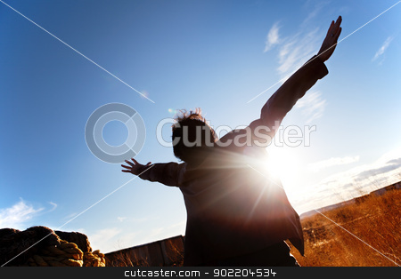 open arms to the sky stock photo, Silhouette of boy with open arms to the sky by carloscastilla