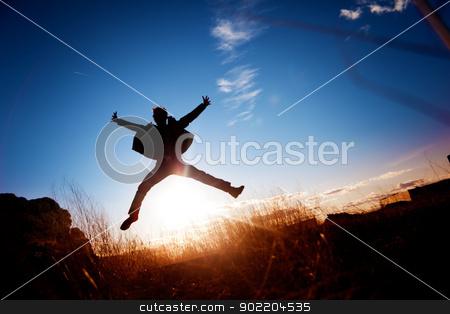 boy jumping  stock photo, Silhouette of boy jumping  by carloscastilla