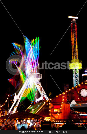 Amusement park stock photo, long exposure pictures of amusement park rides and wheels at night by Desislava Dimitrova