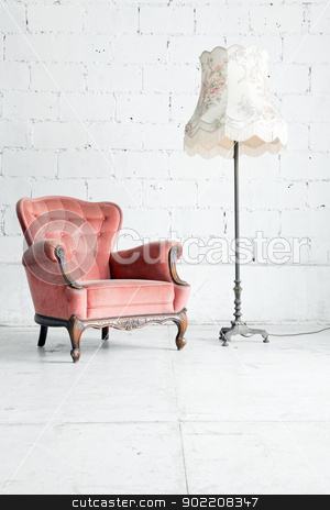 sofa with desk lamp in vintage room stock photo, Pink classical style Armchair sofa couch in vintage room with desk lamp by Vichaya Kiatying-Angsulee
